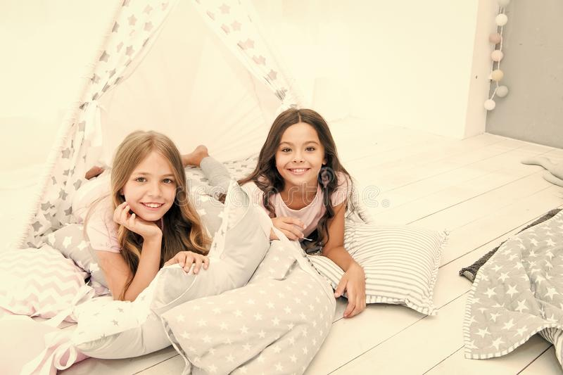 Pajamas party for kids. Siblings best friends. Sisters or best friends spend time together in bedroom. Girls having fun stock photos