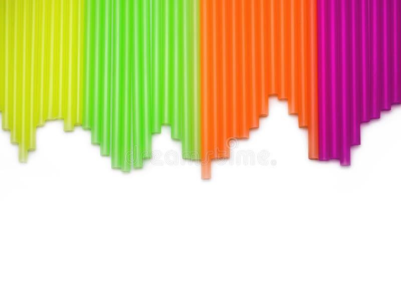 Pajas de beber plásticas coloreadas multi Versión del índice de existencias foto de archivo libre de regalías
