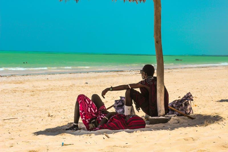 Paje beach. Zanzibar masai people. Paje Zanzibar masai people from arusha try to rest after long day royalty free stock images
