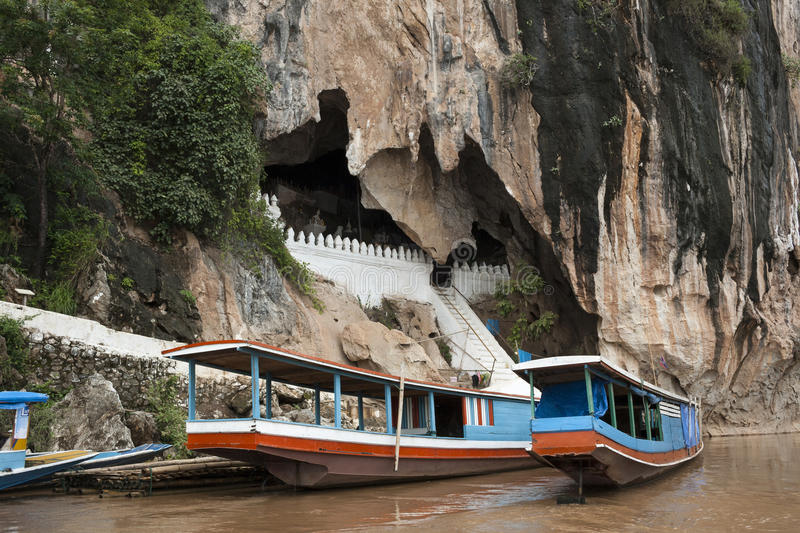 Pak Ou Caves - Tipical tourist boat along Mekong river royalty free stock image