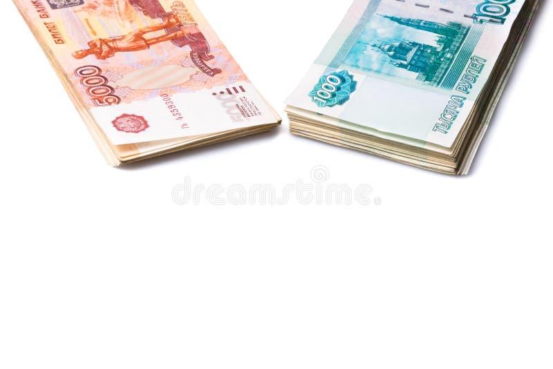 Pak van één en vijf duizend roebelsbankbiljetten royalty-vrije stock foto