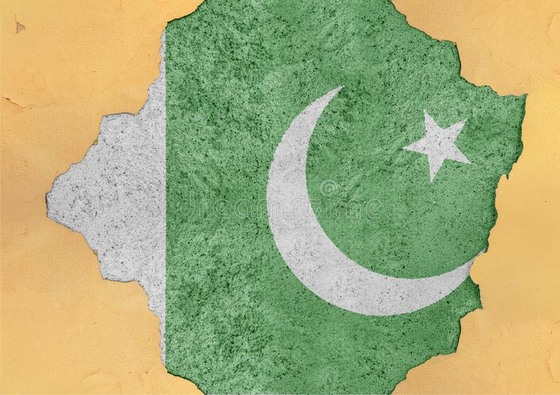 Pakistan flag in big concrete cracked hole and broken material facade. Structure royalty free stock photos