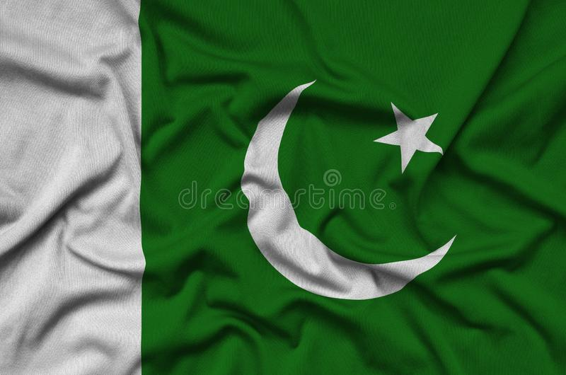 Pakistan flag is depicted on a sports cloth fabric with many folds. Sport team banner royalty free stock photo