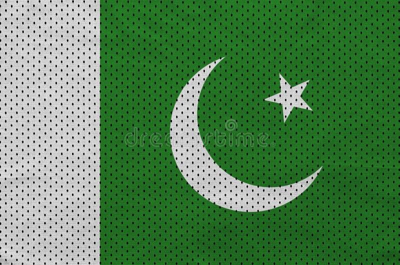 Pakistan flagga som skrivs ut på en fabri för ingrepp för polyesternylonsportswear royaltyfria bilder