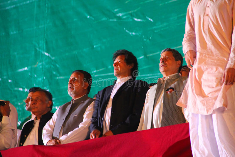 Pakistan Tehreek-e-Insaf Leaders. LAHORE, PAKISTAN - OCT 30: Chairman Pakistan Tehreek-e-Insaf Imran Khan with other PTI leaders standing for national anthem royalty free stock photos