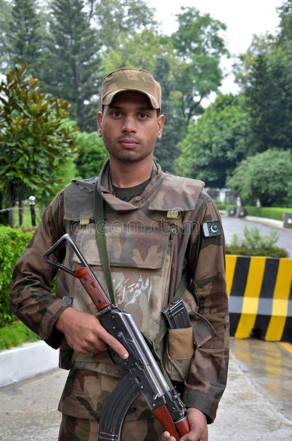 Pakistani infantry soldier stands at guard in the Swat Valley, Pakistan. royalty free stock images