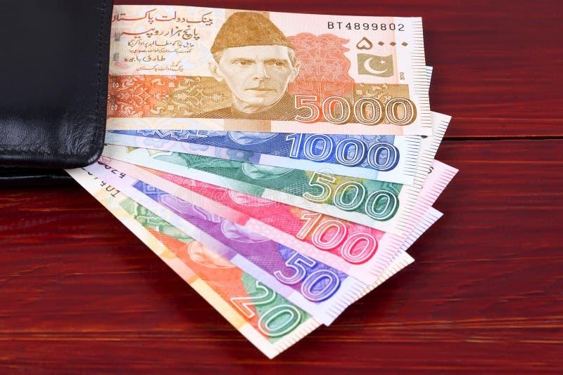 Pakistani Rupee in the black wallet stock photo