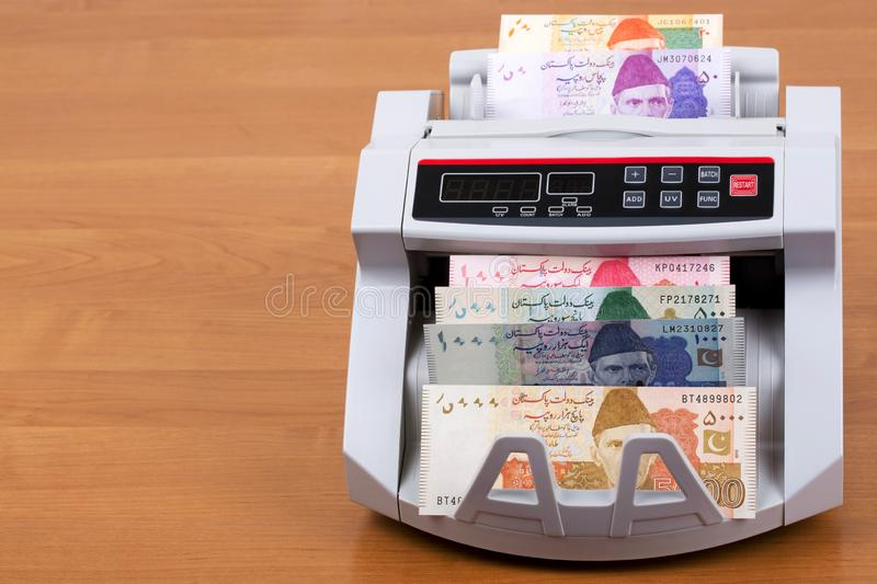 Pakistani Rupee in a counting machine stock image