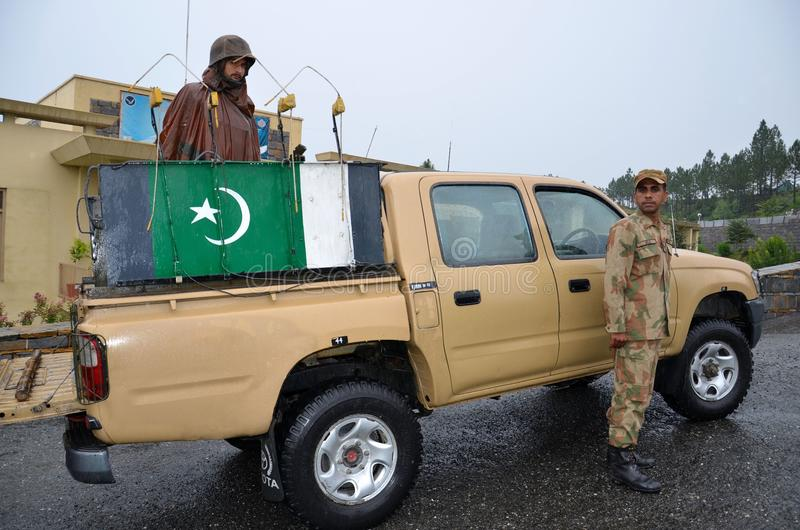 Pakistani soldiers prepare for patrol on pick-up: royalty free stock images