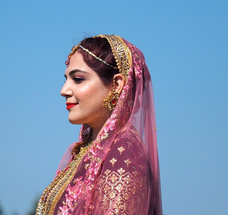 Pakistani Woman In Traditional Wedding Dress royalty free stock image