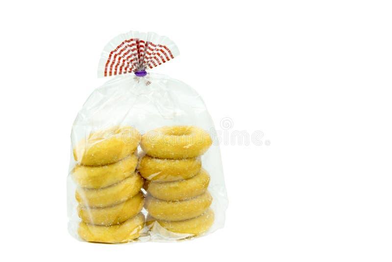 Pakket van donuts op een witte achtergrond stock foto