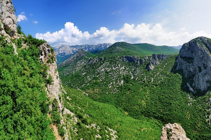 Panorama of Paklenica, Croatia. Paklenica National Park, a national park near Starigrad and Zadar in Croatia. The park is known for its canyons and karst rock stock image