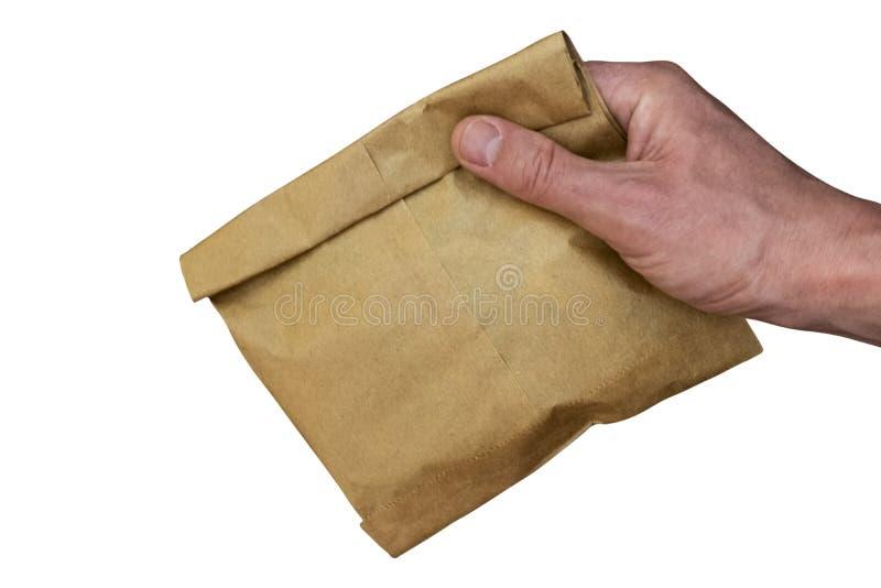 Pakpapierzak in mannelijke hand Ecologisch concept Geïsoleerdj op witte achtergrond royalty-vrije stock foto