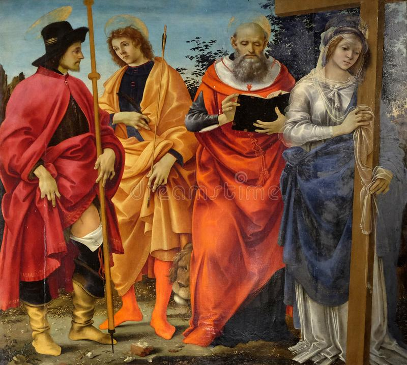 Pala Magrini by Filippino Lippi representing the saints Roch, Sebastian, Jerome and Helena. San Michele in Foro church in Lucca, Tuscany, Italy stock images