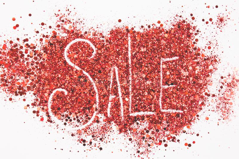 Palabra 'venta 'escrita en un fondo del brillo foto de archivo