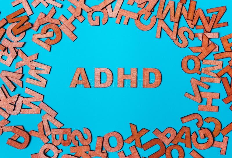 Palabra ADHD de letras de madera fotografía de archivo