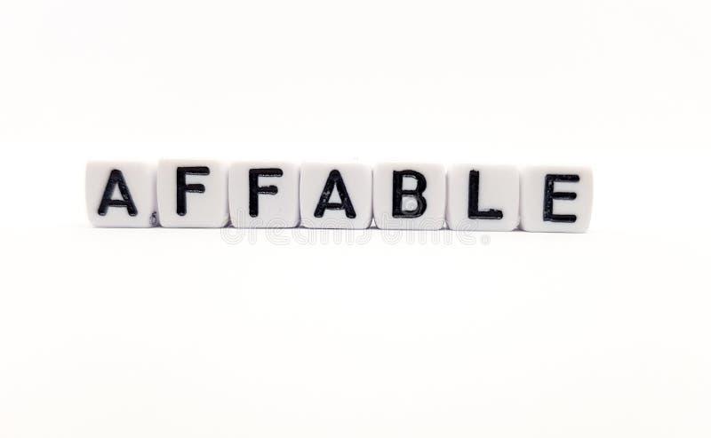 palabra afable construida con los cubos blancos y las letras negras en el fondo blanco fotos de archivo libres de regalías