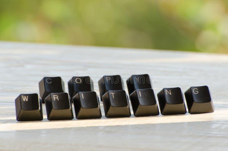 Palabra de Copywriting de llaves individuales en una tabla blanca fotografía de archivo libre de regalías