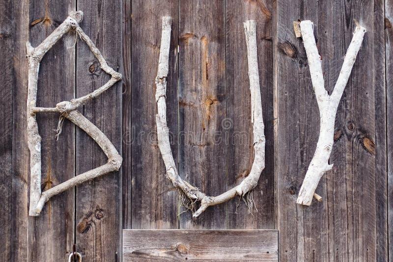 Palabra de la compra del texto, sobre viejo fondo de madera, idea del concepto del ambiente mundial de la reserva de la naturalez foto de archivo libre de regalías