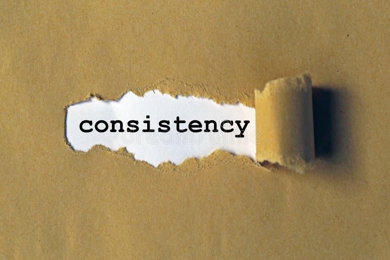 Palabra de la consistencia en el papel imágenes de archivo libres de regalías