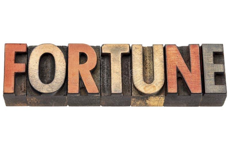 Palabra de la fortuna en tipo de madera del vintage imagenes de archivo