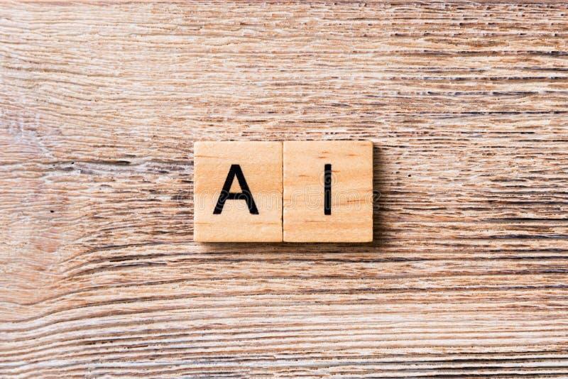 Palabra de la inteligencia artificial escrita en el bloque de madera Texto del AI en la tabla de madera para su desing, concepto fotos de archivo libres de regalías