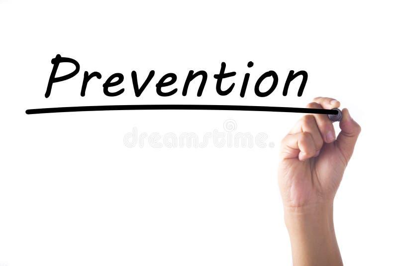 Palabra de la prevención de la escritura de la mano en tablero transparente fotografía de archivo