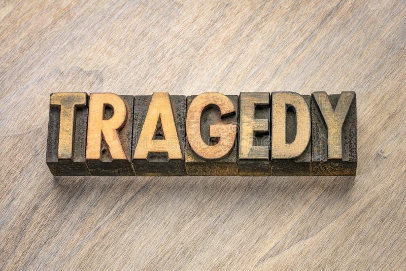 Palabra de la tragedia en tipo de madera de la prensa de copiar foto de archivo