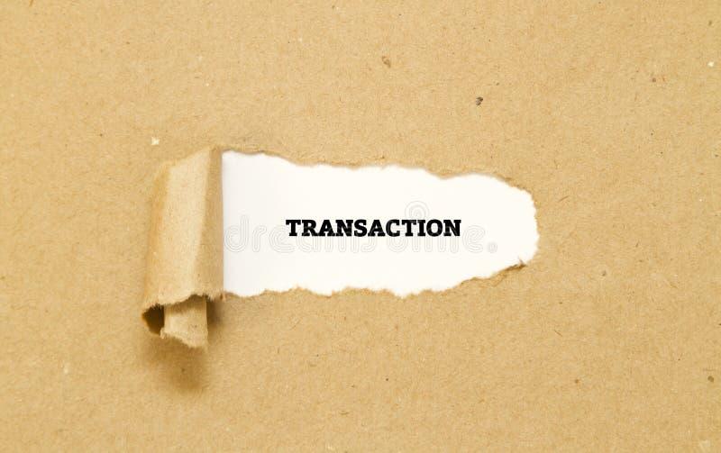 Palabra de la transacción escrita debajo del papel rasgado fotos de archivo