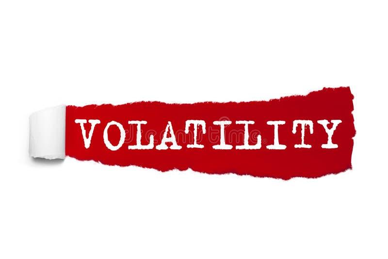 Palabra de la VOLATILIDAD escrita bajo pedazo encrespado de papel rasgado rojo libre illustration