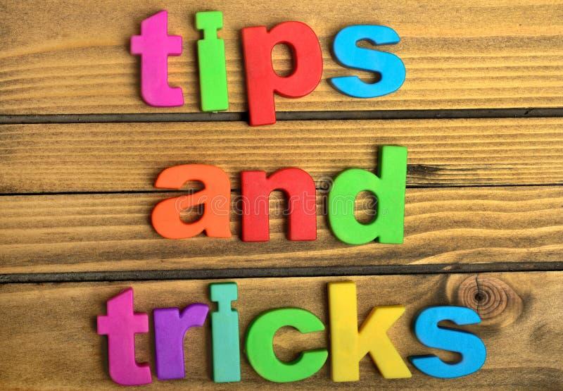 Palabra de las extremidades y de los trucos imagen de archivo