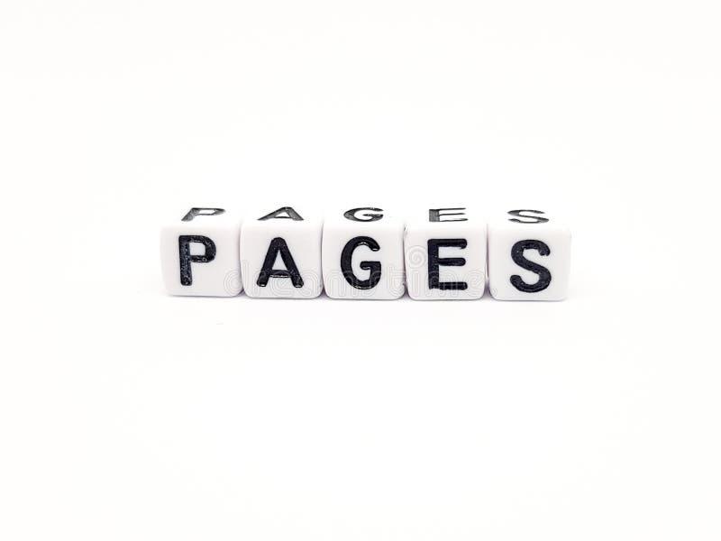 palabra de las páginas de las páginas construida con los cubos blancos y las letras negras en el fondo blanco foto de archivo libre de regalías
