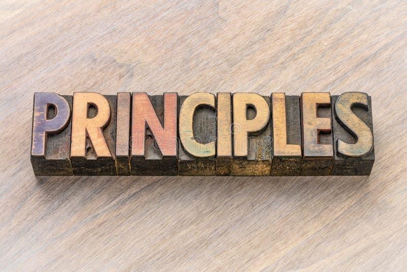 Palabra de los principios en el tipo de madera imagenes de archivo