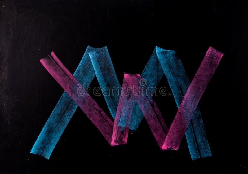 Palabra de W y de M en la pizarra fotografía de archivo libre de regalías