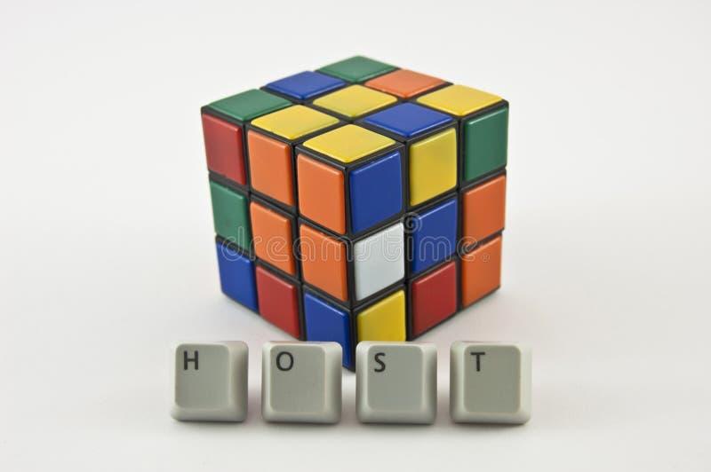 Palabra del anfitrión y cubo del ` s de Rubik imagen de archivo