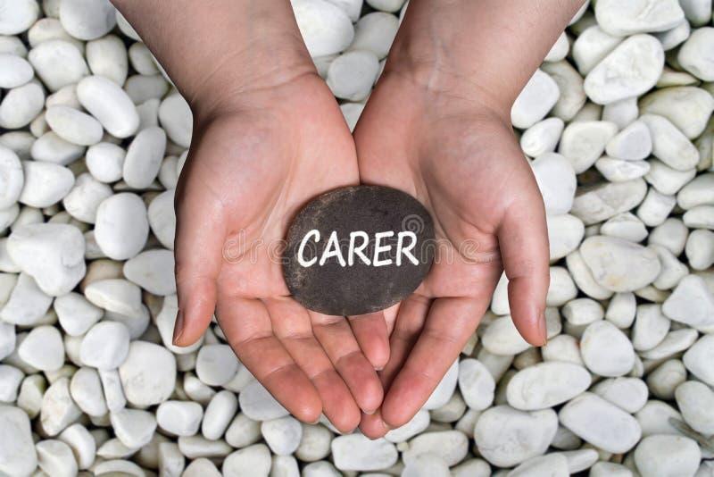Palabra del cuidado en piedra a mano fotos de archivo libres de regalías