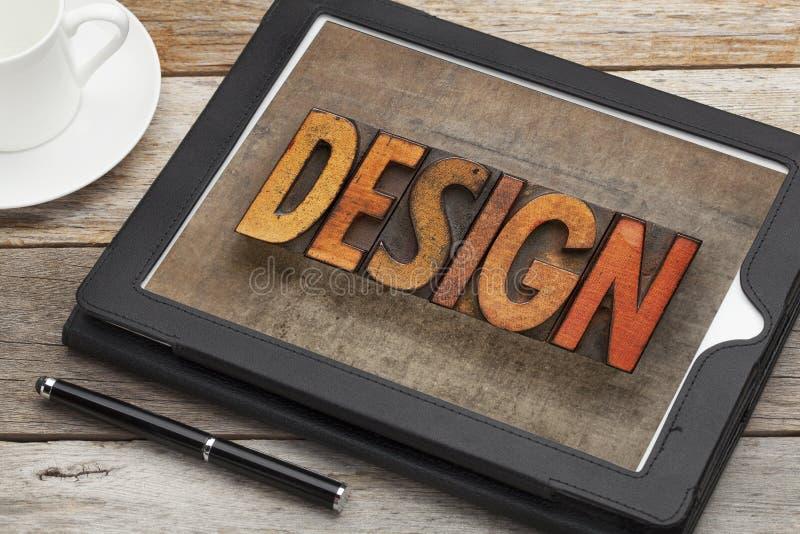 Palabra del diseño en la tableta digital imagen de archivo