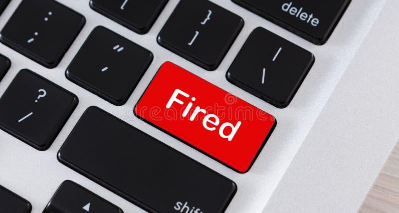 Palabra del fuego en el bot?n rojo del teclado de ordenador fotografía de archivo