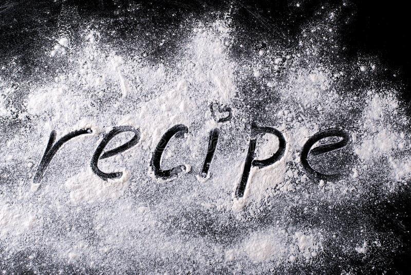 Palabra en la harina de la receta imagenes de archivo