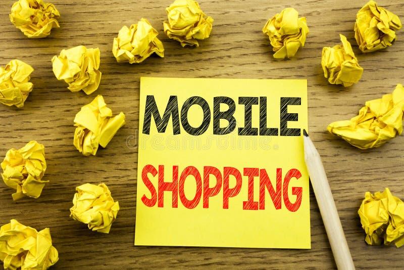 Palabra, escribiendo compras móviles Concepto del negocio para la orden en línea del teléfono móvil escrita en el documento de no imagen de archivo