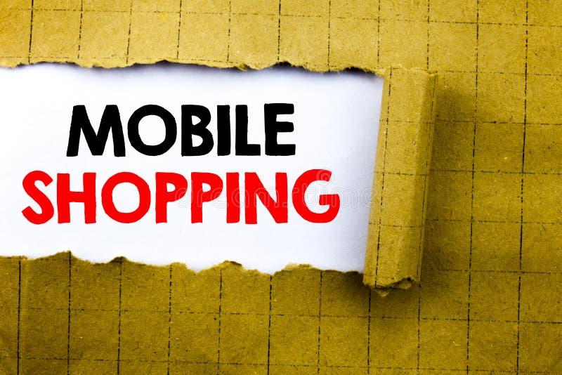 Palabra, escribiendo compras móviles El concepto del negocio para la orden en línea del teléfono móvil escrita en el Libro Blanco imagen de archivo libre de regalías