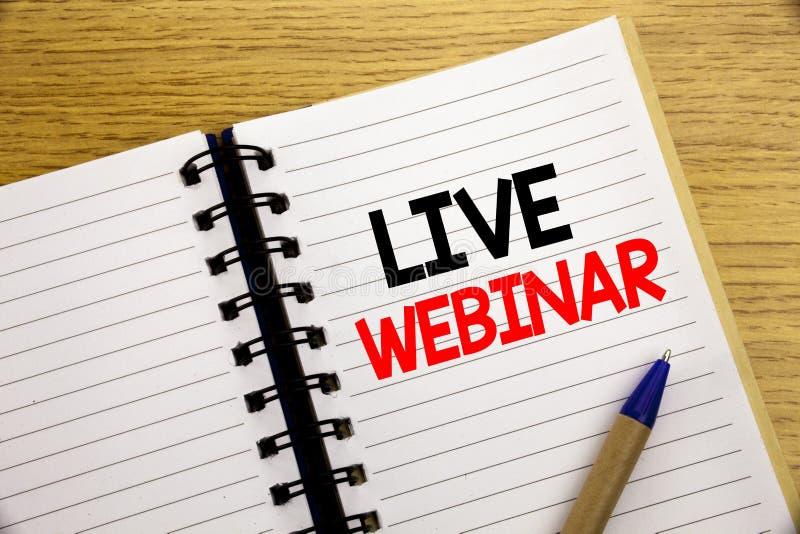 Palabra, escribiendo a Live Webinar Concepto del negocio para el aprendizaje electrónico del web del negocio escrito en la libret fotografía de archivo libre de regalías