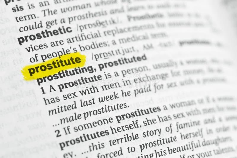 Palabra inglesa destacada y x22; prostitute& x22; y su definición en el diccionario foto de archivo libre de regalías