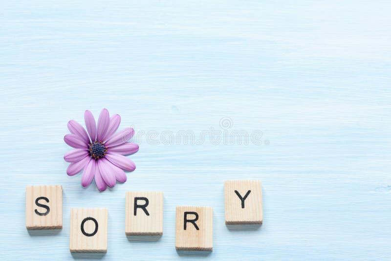Palabra triste y flor foto de archivo