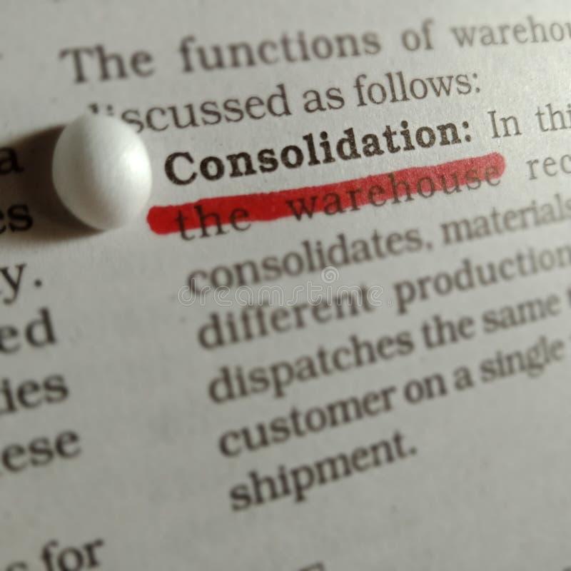 palabras de consolidación que se muestran en el fondo abstracto de la página de papel imagen de archivo libre de regalías
