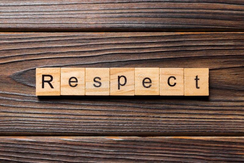 Palabras de respeto escritas en bloques de madera respetar texto en la tabla, concepto imagen de archivo libre de regalías