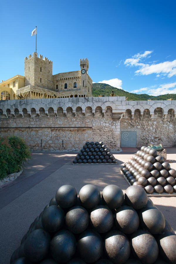 Palace. Pyramids of cannonballs and cannon near Prince Palace in Monaco stock images