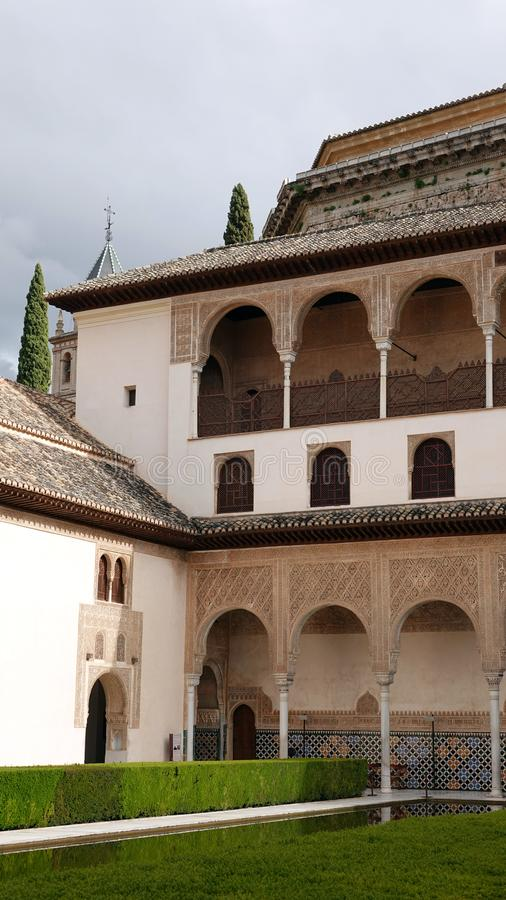 Palacio de Comares at Nasrid palace at the Alhambra in Granada, Andalusia. Palace of Comares at the Court of the Myrtles of the Nasrid complex stock image