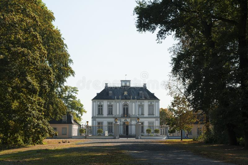 The palace of Falkenlust. The Falkenlust palaces is a historical building complex in Brühl, North Rhine-Westphalia. Germany, which have been listed as a royalty free stock photo