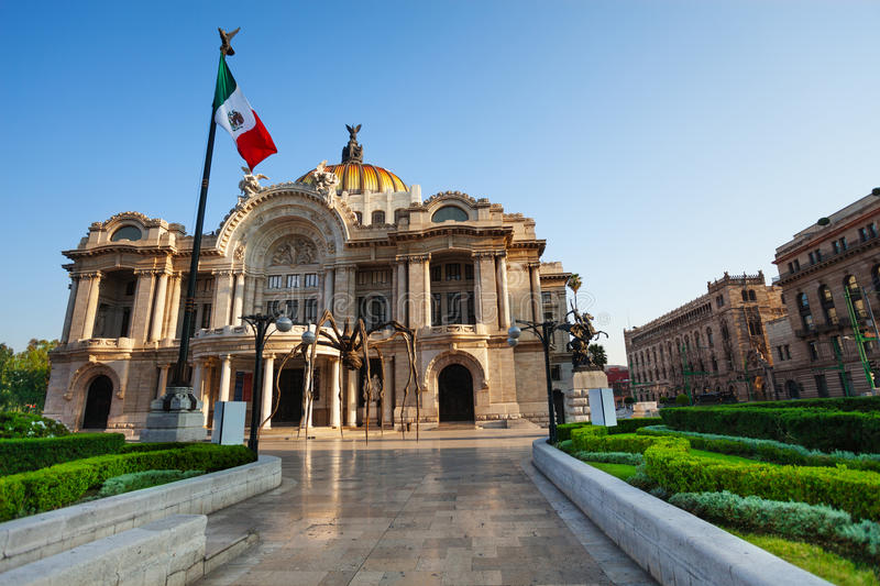 Palace of fine arts facade and Mexican flag. On downtown of Mexico capital city royalty free stock image